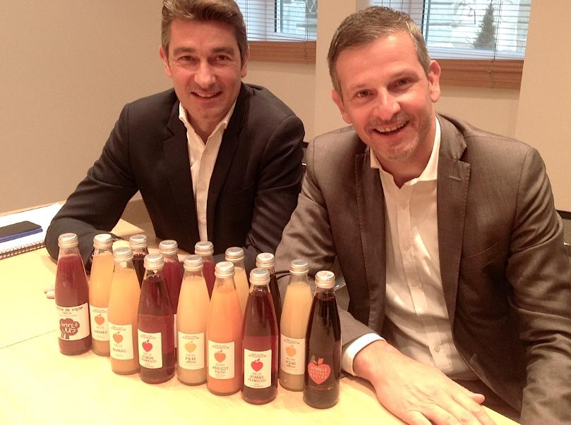 Les deux créateurs lyonnais de Solexia font l'emplettedes jus de fruits Bissardon, haut du gamme et bientôt bio